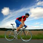 guy in biking gear riding bike on road